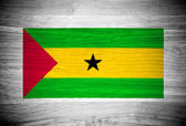 Sao Tome and Principe flag on wood texture — Stock Photo