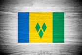 Saint Vincent and the Grenadines flag on wood texture — Stock Photo