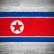 North Korea flag on wood texture — Stock Photo