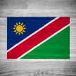 Namibia flag on wood texture — Photo