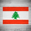 Lebanon flag on wood texture — Stock Photo