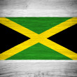 Jamaica flag on wood texture — Stock Photo