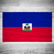 Haiti flag on wood texture — Stock Photo