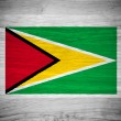 Guyana flag on wood texture — Stock Photo