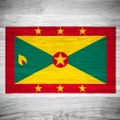 Grenada flag on wood texture — Stock Photo