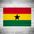 Ghana flag on wood texture — Stock Photo