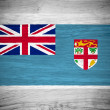 Fiji flag on wood texture — Stock Photo