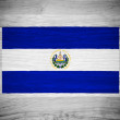 El Salvador flag on wood texture — Stock Photo
