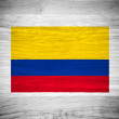 Colombia flag on wood texture — Stock Photo