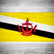 Brunei flag on wood texture — Stock Photo