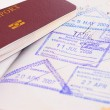 Stock Photo: Passport and immigration stamps