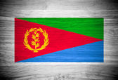 Eritrea flag on wood texture — Stock Photo