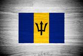 Barbados flag on wood texture — Stock Photo