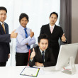 Asian businessman celebrating and giving thumb up — Stock Photo