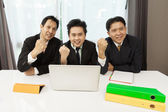 Successful Asian businessman celebrating — Stock Photo