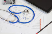 Stethoscope with financial graph — Stock Photo