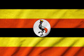 Ruffled Uganda Flag — Stock Photo