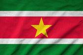 Ruffled Suriname Flag — Stock Photo