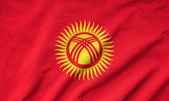 Ruffled Kyrgyzstan Flag — Stock Photo