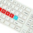 Wording Love on computer keyboard isolated on white background — Stock Photo #35237607