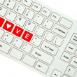 Wording Love on computer keyboard isolated on white background — Stock Photo #35238625