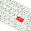 Wording Love on computer keyboard isolated on white background — Stock Photo #35239655