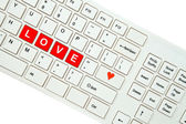 Wording Love on computer keyboard isolated on white background — Stok fotoğraf