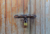Locked wooden door — Stock Photo
