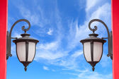 Lamp on red pole — Stock Photo