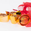 Chinese gold in red sachet — Stock Photo #38444677
