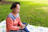 Senior women with mobile phone — Foto de Stock