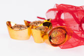 Chinese gold in a red sachet — Stock Photo
