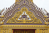 Detail of ornately decorated temple roof — Stock Photo