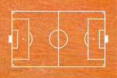 Soccer field layout on wood background — Stock Photo