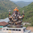 Foto Stock: Giant Hindu God Ganesh on top of building in temple in Tha