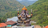 Giant Hindu God Ganesh on top of the building in a temple in Tha — Stock Photo