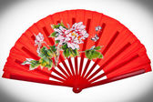 Red oriental chinese fan isolated on white background — Stock Photo