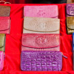 Set of colorful crocodile leather hand bag — Stock Photo