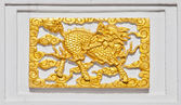 Golden Dragon on temple wall — Stock Photo