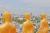 Buddha statue from behind look over the city of Bangkok — Stock Photo