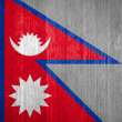 Nepal Flag on wood background — Stock Photo