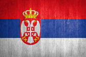 Serbia Flag on wood background — Stock Photo