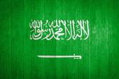 Saudi Arabia Flag on wood background — Stock Photo