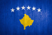 Kosovo Flag on wood background — Stock Photo