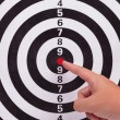 Stock Photo: Hand point to bulls eye target