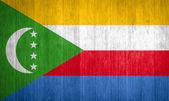 Comoros Flag on wood background — Stock Photo