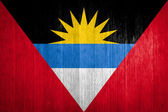 Antigua and Barbuda Flag on wood background — Stock Photo