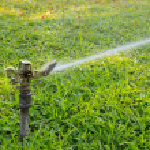 Water sprinkler in outdoor park — Stock Photo