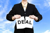 Businessman tear paper with word Deal — Stock Photo