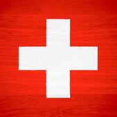 Switzerland flag on wood texture — Stock Photo